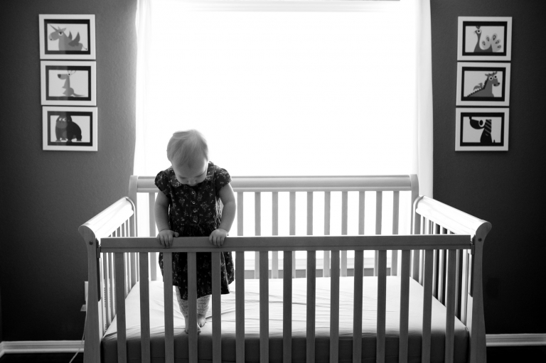 Toledo Ohio Child Photographer girl in crib photo by Cynthia Dawson Photography