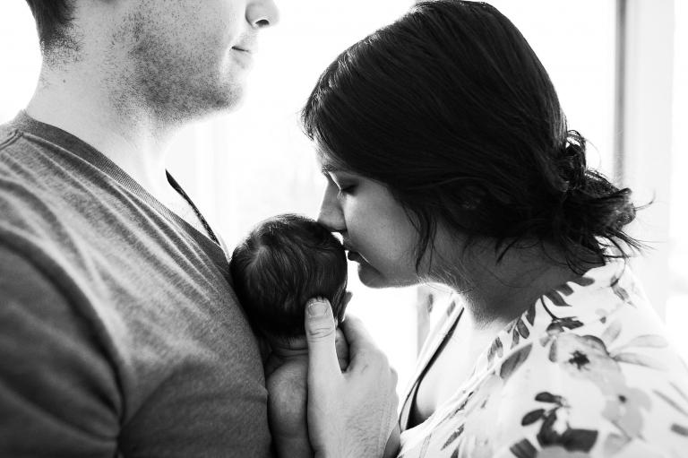 Newborn Lifestyle Photography Toledo Ohio mom kissing baby's head photo by Cynthia Dawson Photography